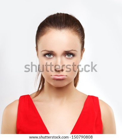 Portrait of disappointed young woman looking at the camera.  - stock photo