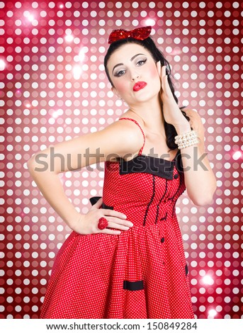 Portrait of disco party dancing girl posing on a bright red dance club background - stock photo