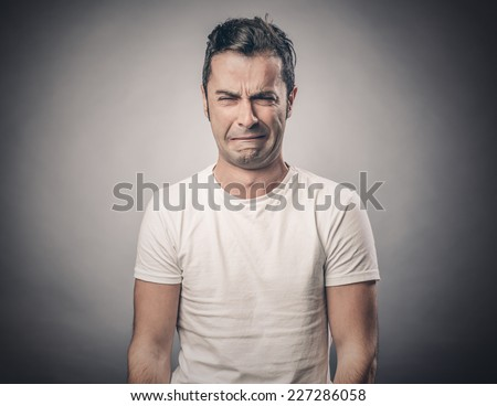 Portrait of disgusted man - stock photo