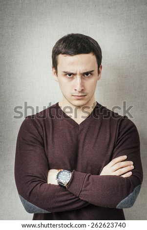 Portrait of disgusted man looking at the camera - stock photo