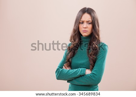 Portrait of displeased and angry woman - stock photo