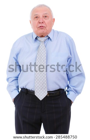 Portrait of Displeased old mature businessman with tie. put hands in trouser pockets isolated on white background. human emotion, facial expression - stock photo