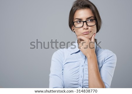 Portrait of dissatisfied young businesswoman - stock photo