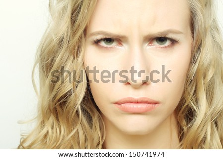 Portrait of dissatisfied young woman - stock photo