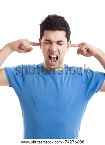 Portrait of disturbed young woman shouting while putting fingers on the ears - stock photo