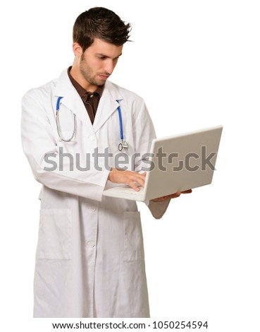 Portrait Of Doctor Holding Laptop On White Background