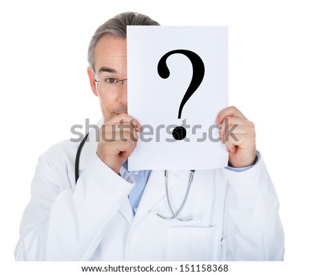 Portrait of doctor holding paper with question mark isolated on white background - stock photo