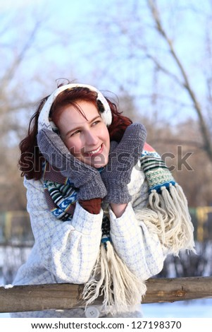 Portrait of dreaming girl in winter park - stock photo