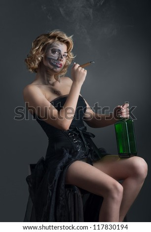 Portrait of drinking and smoking woman with painted skull