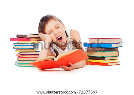 portrait of drowsy little girl with books - stock photo