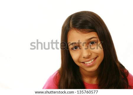 portrait of East Indian girl smiling on white background