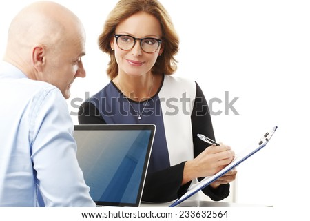 Portrait of efficiency business people consulting while sitting against white background.  - stock photo