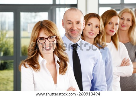 Portrait of efficiency business people standing in a row at office.  - stock photo
