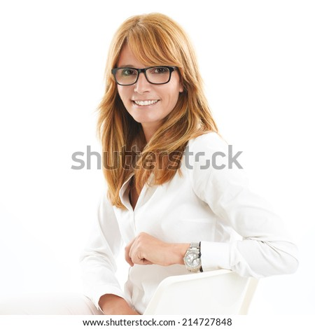 Portrait of efficiency sales manager sitting against white background. - stock photo