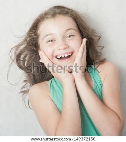 Portrait of  elated litte girl. - stock photo