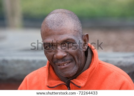 Portrait of elderly African American senior man outside. - stock photo