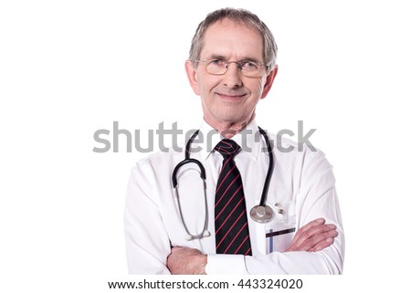Portrait of elderly doctor with folded arms. - stock photo
