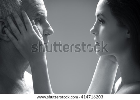 Portrait of elderly father and his young daughter