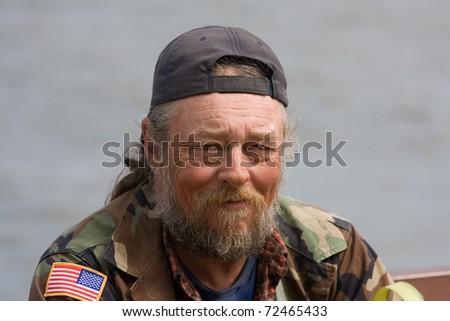 Portrait of elderly homeless white man - stock photo