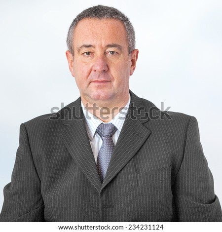 Portrait of elderly man in elegant suit - stock photo