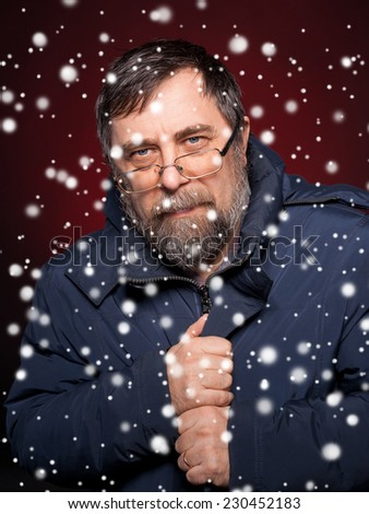 Portrait of elderly man in glasses. Christmas and holidays concept