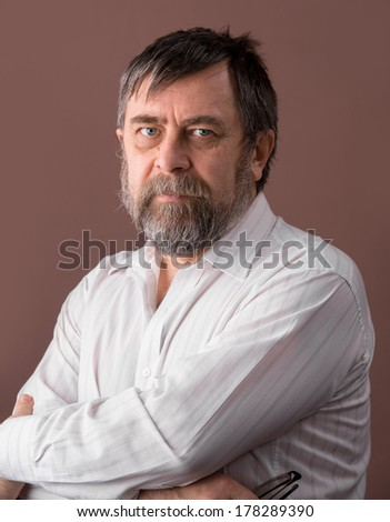 Portrait of  elderly man on a brown background
