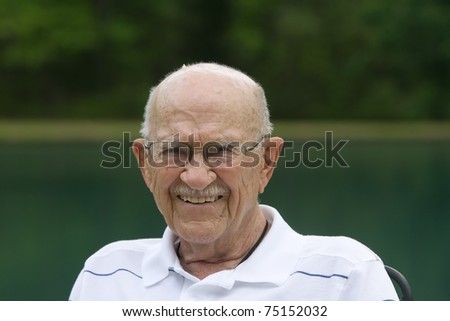 Portrait of elderly man outside during the day - stock photo