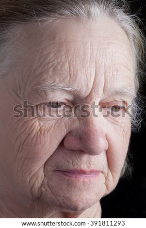 Portrait of elderly woman. Closeup view.