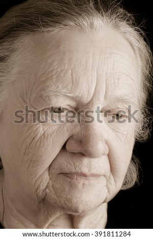 Portrait of elderly woman. Closeup view. Toned.