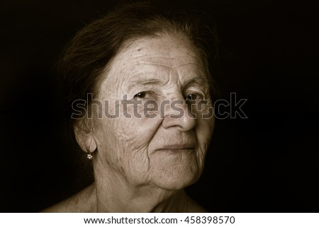 Portrait of elderly woman. Dreaminess. Toned. - stock photo
