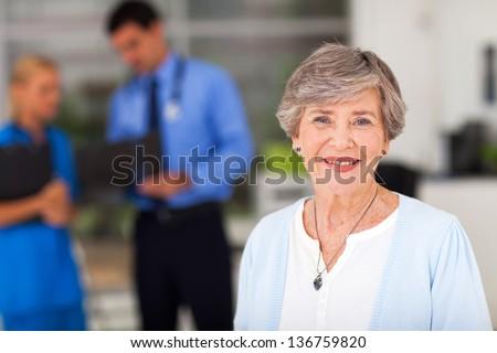 portrait of elderly woman in doctors office - stock photo
