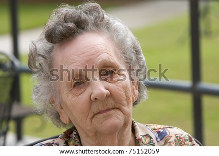 Portrait of elderly woman outside during day - stock photo