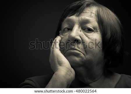 Portrait of elderly woman. Perplexity. Toned.
