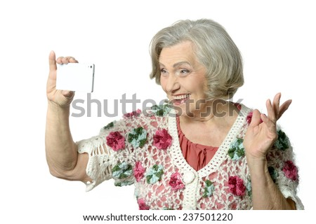 Portrait of elderly woman showing thumbs up on white background - stock photo