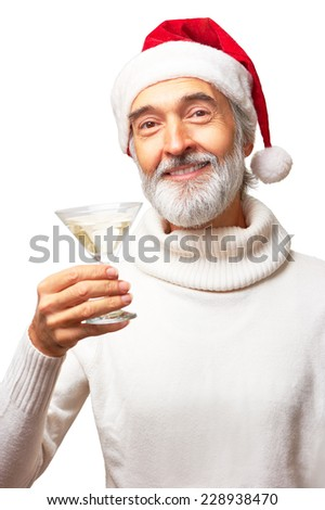 Portrait of eldery handsome man in santa's red hat is going to drink martini holding a glass smiling isolated on white background - stock photo