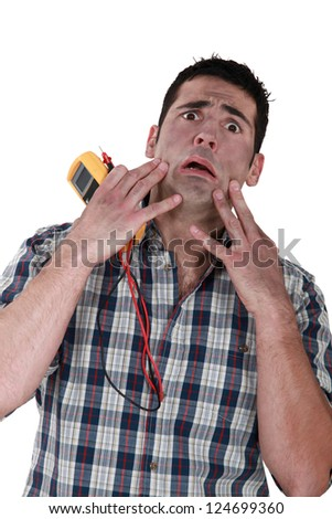 portrait of electrician after electrical hazard - stock photo