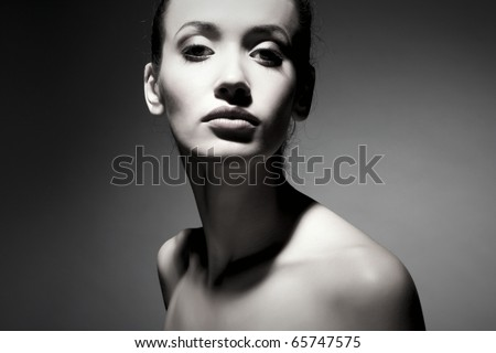 Portrait of elegant brunette woman - stock photo