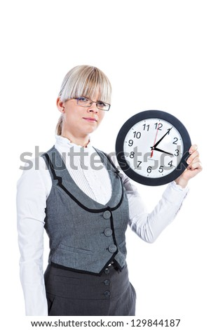 Portrait of elegant business woman holding big clock on white background