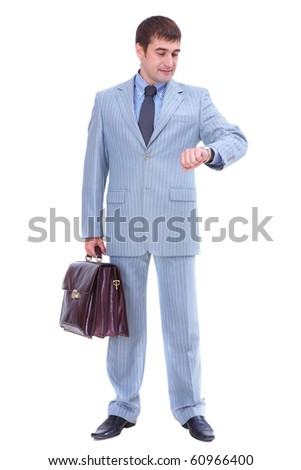 Portrait of elegant businessman in grey suit looking at his watch in isolation - stock photo