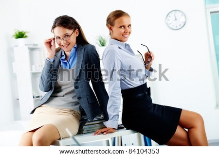 Portrait of elegant businesswomen posing in office