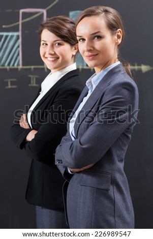 Portrait of elegant businesswomen working in office