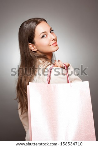 Portrait of elegant cool brunette beauty with shopping bags.