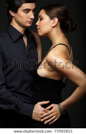 Portrait of elegant couple on black background