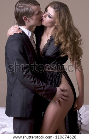 Portrait of elegant couple on grey background - stock photo