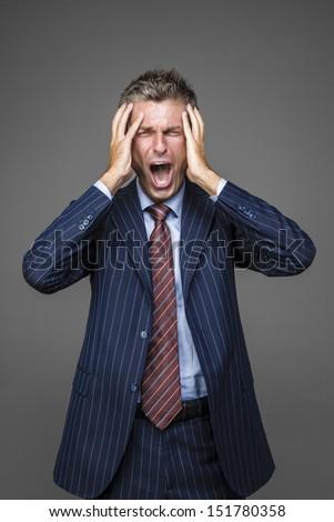 Portrait of elegant desperate businessman shouting and screaming - stock photo
