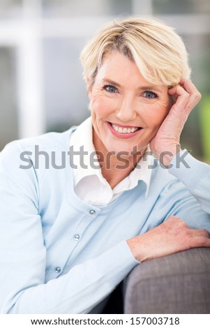 portrait of elegant elderly woman sitting at home