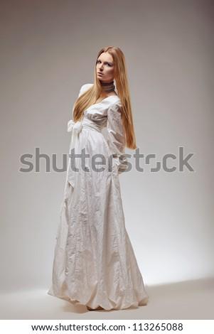Portrait of elegant fashion woman in medieval era dress. - stock photo