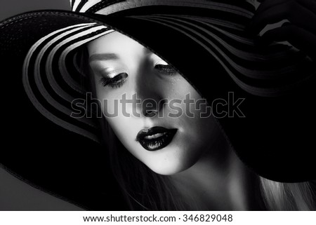 portrait of elegant fashionable woman in a hat - stock photo