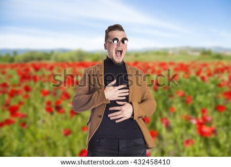 portrait of elegant guy with glasses laughing - stock photo