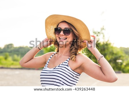 Portrait of elegant lady in hat on summer vacation - stock photo